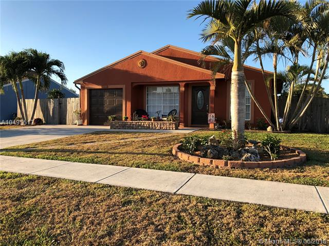Home for sale in COUNTERPOINT ESTATES 8 Royal Palm Beach Florida